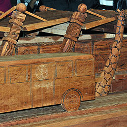 Detail of an exquisite wood-carving of a Rea Vaya bus and station unveiled at the launch